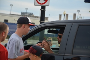 A photo my mom took of Ian Desmond signing my baseball